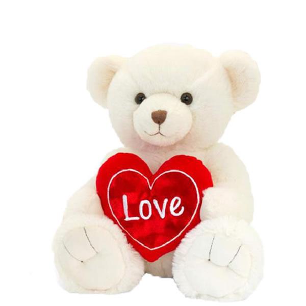 Plüss Snuggles maci szívvel, krém 25 cm